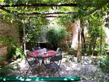 View of the garden and canopy with dinner table set