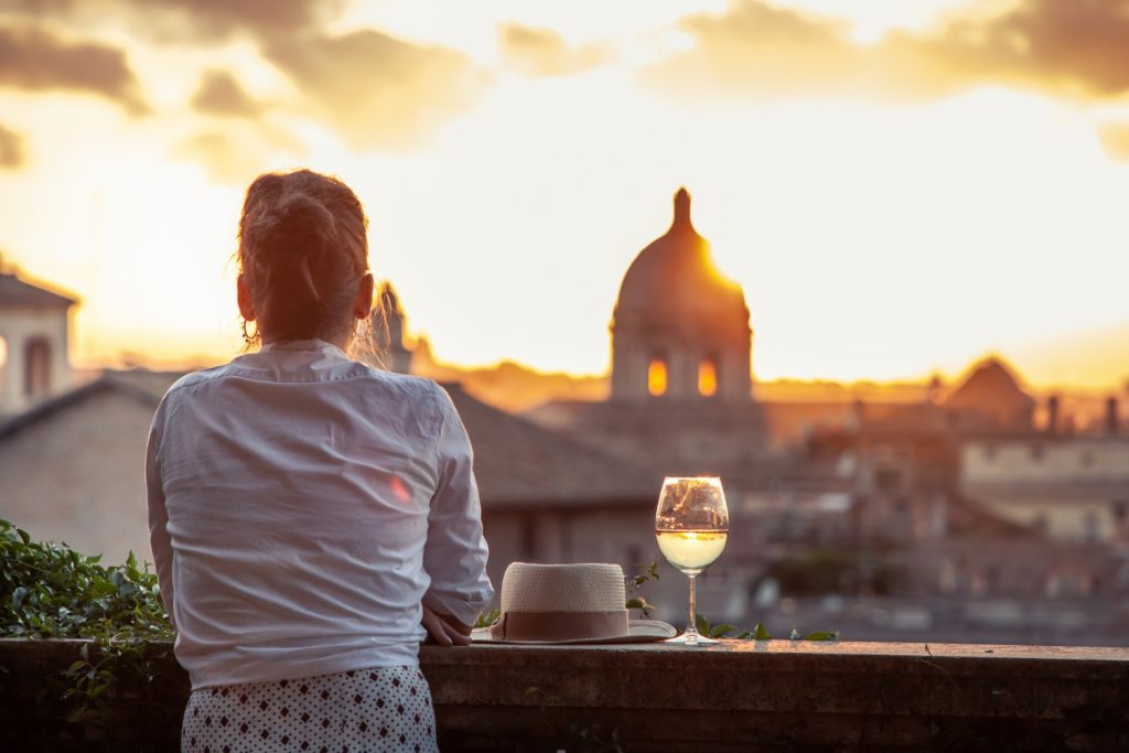 Woman drinking wine at sunset in Rome
